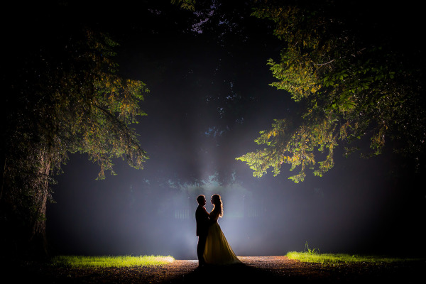 couple embracing in the forest